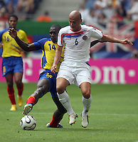 Ecuador's Segundo Castillo (14) and Costa Rica's Danny Fonseca (6) battle for the ball in Hamburg, Germany, Thursday, June 15, 2006.