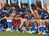 Mario Balotelli of Italy shows a look of dejection sat on the substitutes bench after being taken off at half time
