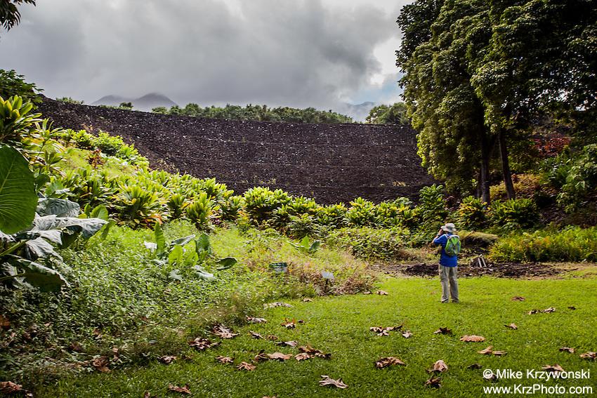 VIsitor photogrpahing the Pi'ilanihale Heiau at the Kahanu Garden, on the road to Hana, Maui