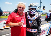 Jun 8, 2019; Topeka, KS, USA; NHRA top fuel driver Scott Palmer (right) with sponsor Tommy Thompson during qualifying for the Heartland Nationals at Heartland Motorsports Park. Mandatory Credit: Mark J. Rebilas-USA TODAY Sports