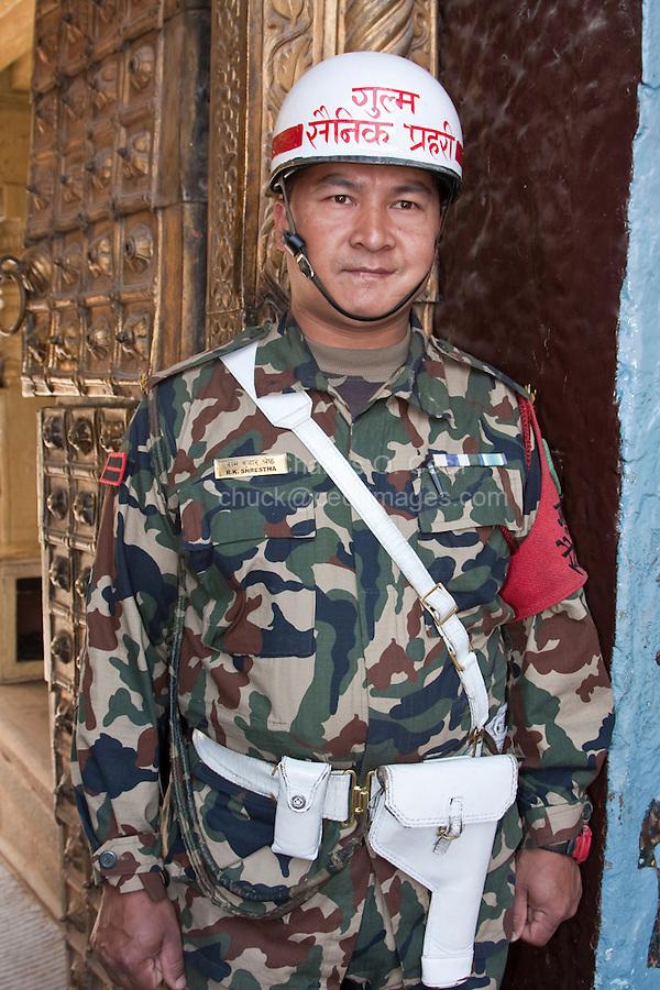 Kathmandu, Nepal.  Nepali Guard at the Entrance to the Hanuman Dhoka, a Former Royal Palace, Durbar Square.