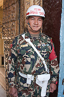 Kathmandu, Nepal.  Nepali Guard at the Entrance to the Hanuman Dhoka, a Former Royal Palace, Durbar Square.