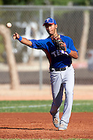 Texas Rangers minor league infielder Smerling Lantigua #9 during an instructional league game against a Korean All-Star team at the Surprise Stadium Complex on October 13, 2012 in Surprise, Arizona.  (Mike Janes/Four Seam Images)