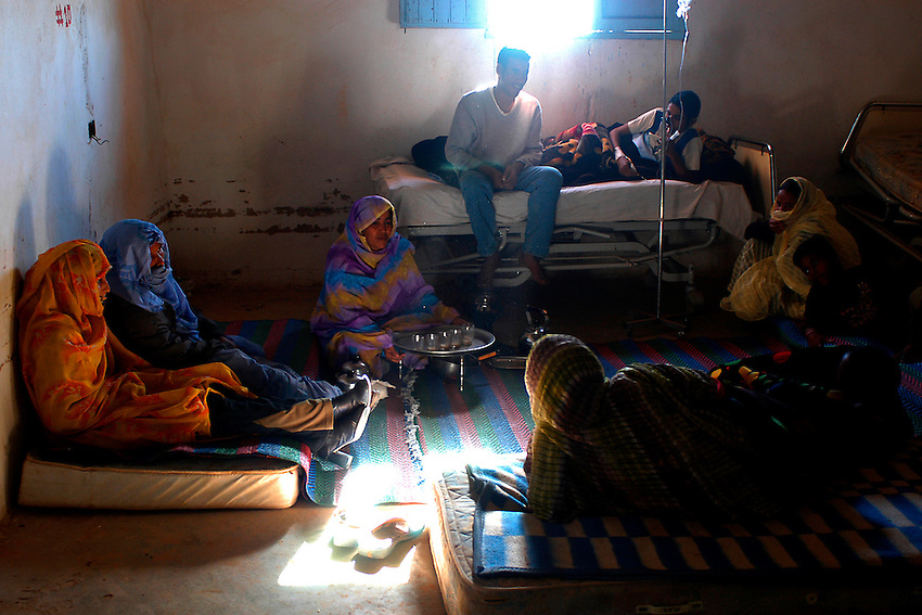 A family takes a tea on December 13, 2003, in a hospital of Ausserd. Saharawi people have been living at the refugee camps of the Algerian desert named Hamada, or desert of the deserts, for more than 30 years now. Saharawi people have suffered the consecuences of European colonialism and the war against occupation by Moroccan forces. Polisario and Moroccan Army are in conflict since 1975 when Hassan II, Moroccan King in 1975, sent more than 250.000 civilians and soldiers to colonize the Western Sahara when Spain left the country. Since 1991 they are in a peace process without any outcome so far. (Ander Gillenea / Bostok Photo)