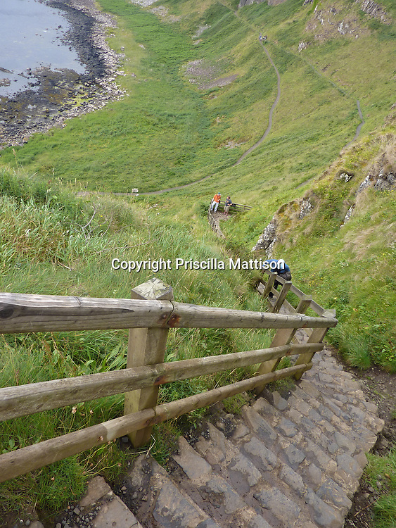 County Antrim, Northern Ireland - July 14, 2010:  Visitors face a steep stairway at the Giant's Causeway.