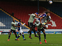 3rd October 2020; Ewood Park, Blackburn, Lancashire, England; English Football League Championship Football, Blackburn Rovers versus Cardiff City; Greg Cunningham of Cardiff City leaps to win a clearance in a crowded penalty area