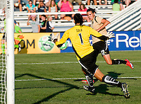 FC Gold Pride forward Christine Sinclair (12) scores a gaol off of Saint Louis Athletica goalkeeper Hope Solo (1) during a WPS match at Anheuser-Busch Soccer Park, in St. Louis, MO, July 26, 2009. The match ended in a 1-1 tie.