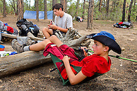 Photo story of Philmont Scout Ranch in Cimarron, New Mexico, taken during a Boy Scout Troop backpack trip in the summer of 2013. Photo is part of a comprehensive picture package which shows in-depth photography of a BSA Ventures crew on a trek.  In this photo BSA Venture Crew Scouts relax around the campsite after setting up camp for the night in the backcountry at Philmont Scout Ranch.   <br /> <br /> The  Photo by travel photograph: PatrickschneiderPhoto.com