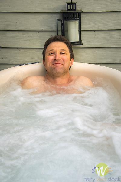 Man in hot tub.