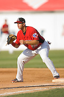 First baseman Michael Ortiz #21 of the Hickory Crawdads waits for a throw against the Rome Braves at  L.P. Frans Stadium May 23, 2010, in Hickory, North Carolina.  The Rome Braves defeated the Hickory Crawdads 5-1.  Photo by Brian Westerholt / Four Seam Images