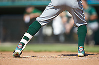 A closeup of the colorful cleats worn by Lolo Sanchez (26) of the Greensboro Grasshoppers during the game against the Kannapolis Intimidators at Kannapolis Intimidators Stadium on June 16, 2019 in Kannapolis, North Carolina. The Grasshoppers defeated the Boll Weevils 5-2. (Brian Westerholt/Four Seam Images)