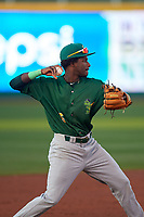 Beloit Snappers shortstop Marcos Brito (6) throws to first base during a Midwest League game against the Lansing Lugnuts at Cooley Law School Stadium on May 4, 2019 in Lansing, Michigan. Beloit defeated Lansing 2-1. (Zachary Lucy/Four Seam Images)