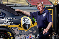 19 June, 2011: NASCAR Hall of Fame Inductee Bud Moore poses with the number 39 Sprint Cup car of Ryan Newman in celebration of the Army's 236 birthday prior to qualifying for the 43rd Annual Heluva Good! Sour Cream Dips 400 at Michigan International Speedway in Brooklyn, Michigan. (Photo by Jeff Speer :: SpeerPhoto.com)