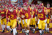 LOS ANGELES, CA - SEPTEMBER 11: Jaxson Dart #2 and Kedon Slovis #9 of the USC Trojans lead the team out for warmups before a game between University of Southern California and Stanford Football at Los Angeles Memorial Coliseum on September 11, 2021 in Los Angeles, California.
