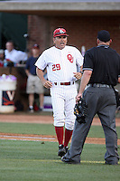 Sunny Golloway, head coach of the Oklahoma Sooners, disputes a call in Game Two of the NCAA Super Regional tournament against the Virginia Cavaliers at Charlottesville, VA - 06/13/2010. Oklahoma defeated Virginia, 10-7, to tie the series after two games.  Photo By Bill Mitchell / Four Seam Images