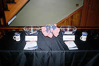 American flags stand in a cup on a table with campaign materials and forms for asking questions of Cruz before Texas senator and Republican presidential candidate Ted Cruz speaks at a town hall put on by the Concerned Veterans for American at Milford Town Hall in Milford, New Hampshire.