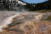 The Excelsior Geyser Crater drains into the Firehole River in Yellowstone National Park, Wyoming on Tuesday, May 23, 2017. (Photo by James Brosher)