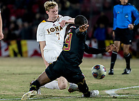 COLLEGE PARK, MD - NOVEMBER 21: Josh Plimpton #7 of Iona winds up to shoot past Fola Adetola #29 of Maryland during a game between Iona College and University of Maryland at Ludwig Field on November 21, 2019 in College Park, Maryland.