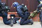 © Joel Goodman - 07973 332324 - all rights reserved . 05/02/2011 . Luton , UK . A police medic tends to an injured anti-fascist counter-protester . The English Defence League ( EDL ) hold a march and demonstration against Islamic fundamentalism in Luton . Photo credit : Joel Goodman
