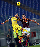 Calcio, Serie A: Roma vs ChievoVerona. Roma, stadio Olimpico, 31 ottobre 2013.<br /> ChievoVerona forward Sergio Pellissier, left, and AS Roma defender Vasilis Torosidis, of Greece, jump for the ball during the Italian Serie A football match between AS Roma and ChievoVerona at Rome's Olympic stadium, 31 October 2013.<br /> UPDATE IMAGES PRESS/Riccardo De Luca