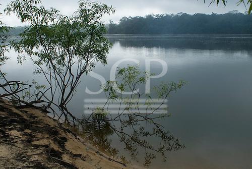 Pará State, Brazil. Xingu River. Early morning mist.