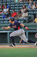 Catcher Jonathan Morales (8) of the Rome Braves bats in a game against the Greenville Drive on Wednesday, August 31, 2016, at Fluor Field at the West End in Greenville, South Carolina. Rome won, 9-1. (Tom Priddy/Four Seam Images)