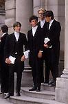 Eton College schoolboys in traditional uniform.  Windsor Berkshire.  1980s  UK