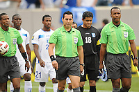 Referee Roberto Moreno entering the field. Honduras defeated Costa Rica in Penalty Kick 4-2 in the quaterfinals for the 2011 CONCACAF Gold Cup , at the New Meadowlands Stadium, Saturday June 18, 2011.