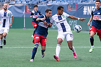 FOXBOROUGH, MA - JULY 4: Tyler Freitas #54 of the New England Revolution II and Joshua Donnelly #17 of Greenville Triumph SC battle for the ball during a game between Greenville Triumph SC and New England Revolution II at Gillette Stadium on July 4, 2021 in Foxborough, Massachusetts.