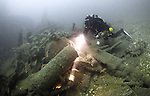 A technical diver explores wreckage on the Liberty Ship Fort Yale, sunk by torpedo in 1944, English Channel, United Kingdom