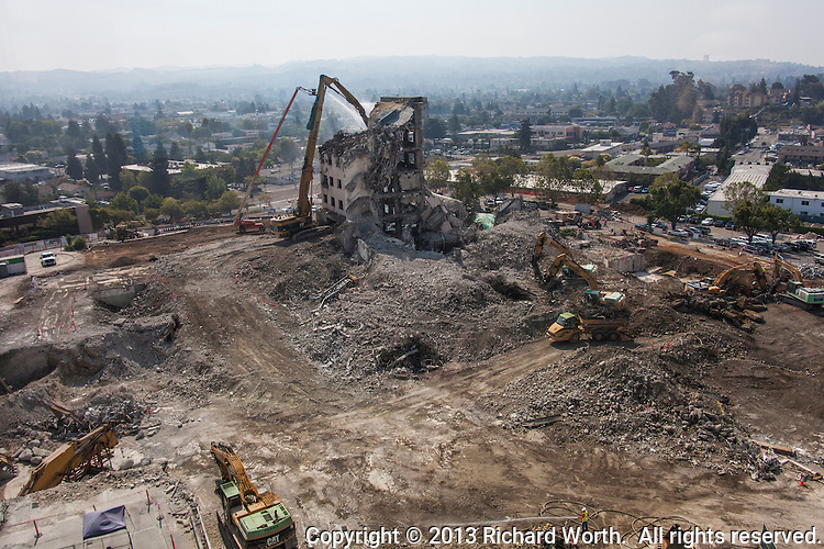 """Demolition or deconstruction, is progressing on the former Eden Hospital in Castro Valley, California.  The new Eden Medical Center opened December 1, 2012.  Summit Health calls the process deconstruction, """"because of the selective, targeted work involved and the recycling process—"""""""