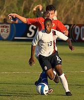 U-17 MNT midfielder Joseph-Claude Gyau (13, white) pushes the ball past a Russian defender. The U-17 Men's National Team defeated Russia 2-0 at the Development Academy Nike Friendlies. December 6, 2007, Bradenton, Fla.