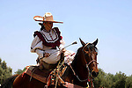 MEXICAN WOMAN DEMONSTRATES HER EQUESTRIAN SKILLS at the ANNUAL WINE FESTIVAL