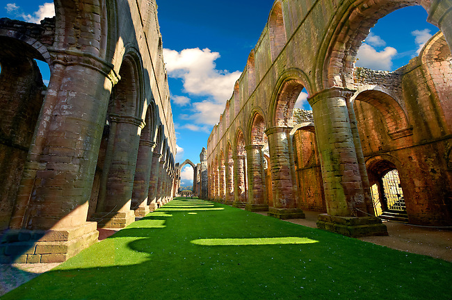 Central Aisle of Fountains Abbey , founded in 1132, is one of the largest and best preserved ruined Cistercian monasteries in England. The ruined monastery is a focal point of England's most important 18th century Water, the Studley Royal Water Garden which is a UNESCO World Heritage Site. Near Ripon, North Yorkshire, England