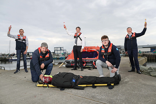 Senior instructor Joe Maloney demonstrates safety training to NFCI students Ciaran Ivers(on left) and Ross Conneely (2nd from right) while Minister McConalogue and Jim O'Toole, CEO, Bord Iascaigh Mhara look on