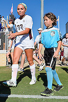 Texas A&M midfielder Mikaela Harvey (77) enters the field accompanied by a fan before NCAA soccer game, Sunday, October 26, 2014 in College Station, Tex. South Carolina draw 2-2 against Texas A&M in double overtime. (Mo Khursheed/TFV Media via AP Images)