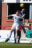 24th April 2021; Dens Park, Dundee, Scotland; Scottish Championship Football, Dundee FC versus Raith Rovers; Charlie Adam of Dundee competes in the air with Brad Spencer of Raith Rovers