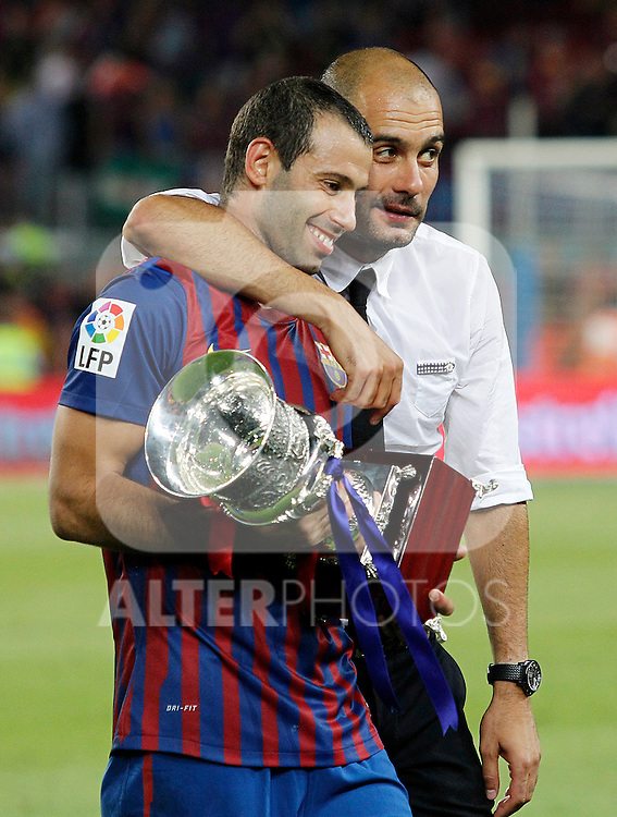 FC Barcelona's coach coach Pep Guardiola (r) and Javier Mascherano celebrates the victory during Spanish Supercup 2nd match.August 17,2011. (ALTERPHOTOS/Acero)