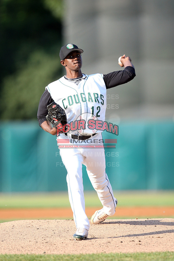 May 27, 2010: Anvioris Ramirez (12) of the Kane County Cougars at Elfstrom Stadium in Geneva, IL. The Cougars are the Midwest League Class A affiliate of the Oakland Athletics. Photo by: Chris Proctor/Four Seam Images