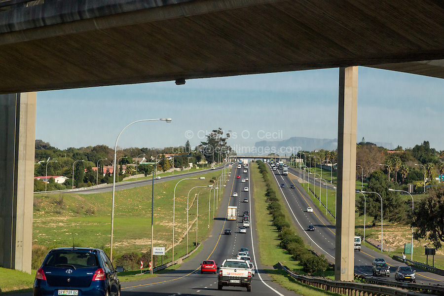 South Africa, Cape Town.  Divided Highway headed toward Cape Town.  Driving on the left.  Table Mountain in the distance.