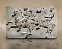 Marble Releif Sculptures from the frieze around the Parthenon Block II. From the Parthenon of the Acropolis Athens. A British Museum Exhibit known as The Elgin Marbles