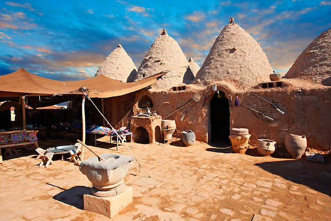 """Pictures of the beehive adobe buildings of Harran, south west Anatolia, Turkey.  Harran was a major ancient city in Upper Mesopotamia whose site is near the modern village of Altınbaşak, Turkey, 24 miles (44 kilometers) southeast of Şanlıurfa. The location is in a district of Şanlıurfa Province that is also named """"Harran"""". Harran is famous for its traditional 'beehive' adobe houses, constructed entirely without wood. The design of these makes them cool inside. 19"""