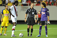 Emmanuel Adebayor, referee Mark Geiger, and goalkeeper Guillermo Ochoa gather around the penalty spot before Adebayor staked his team to a 1-0, first-half lead from the spot. The 2010 Atlanta International Soccer Challenge was held, Wednesday, July 28, at the Georgia Dome, featuring a match between Club America and Manchester City. After regulation time ended 1-1, Manchester City was awarded the victory, winning 4-1, in penalty kicks.
