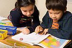 Grade 3 geography boy and girl working with map and talking