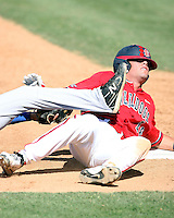Danny Muno #16 of the Fresno State Bulldogs slides safely into third base around the tag of third baseman Mark Threldeld #26 in a game against the Louisiana Tech Bulldogs in the Western Athletic Conference post-season tournament at Hohokam Stadium on May 26, 2011 in Mesa, Arizona. .Photo by:  Bill Mitchell/Four Seam Images.