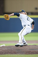 Michigan Wolverines pitcher Willie Weiss (20) delivers a pitch to the plate against the Michigan State Spartans on March 22, 2021 in NCAA baseball action at Ray Fisher Stadium in Ann Arbor, Michigan. Michigan State beat the Wolverines 3-0. (Andrew Woolley/Four Seam Images)