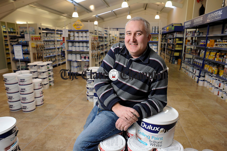 Roger Fox at work in Shanahan Paints. Photograph by John Kelly.