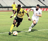Keithy Simpson (3) dribbles against Peri Marosevic. US Under-20 Men's National Team defeated Jamaica 3-0 at Dwight Yorke Stadium in Bacolet, Tobago on March 6, 2009. Photo by Clement Williams/ isiphotos.com