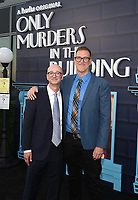 """NEW YORK CITY - AUG 24: (L-R) Executive Producers Jess Rosenthal and John Hoffman attend the screening of Hulu's """"Only Murders in the Building"""" at The Greens at Pier 17 on August 24, 2021 in New York City. (Photo by Frank Micelotta/Hulu/PictureGroup)"""