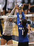 Nevada's Sam Willouoghby (10) and Air Force's Raquel Rosas (13) compete in a college volleyball match in Reno, Nev., on Thursday, Sept. 25, 2014. Air Force won 3-2.<br /> Photo by Cathleen Allison